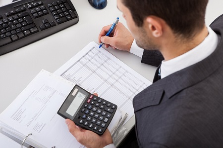 Accountant calculating cost